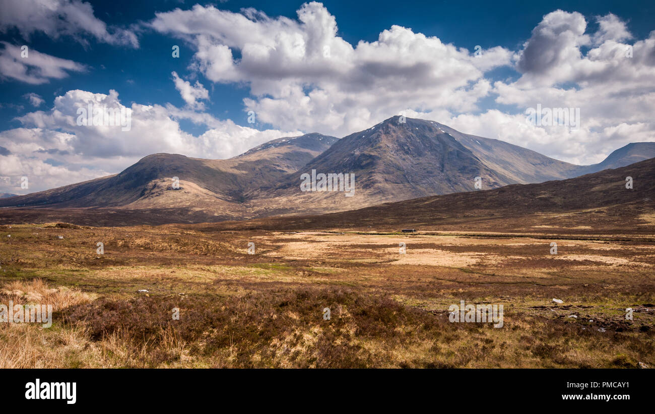 The Black Mount group of mountains, including Stob a' Ghlais Choire and Creise, rise from the bleak peat bog landscape of Rannoch Moor in the West Hig - Stock Image