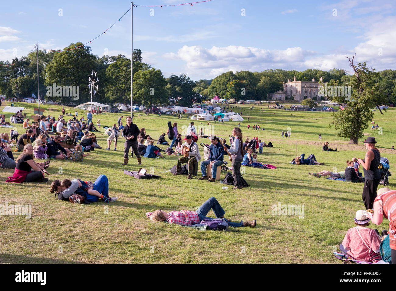 Chepstow, Wales – Aug 16: People relax, and laze about, enjoying the peace an tranquiity of a sunny Sunday on 16 Aug 2015 at the Green Gathering Festi - Stock Image