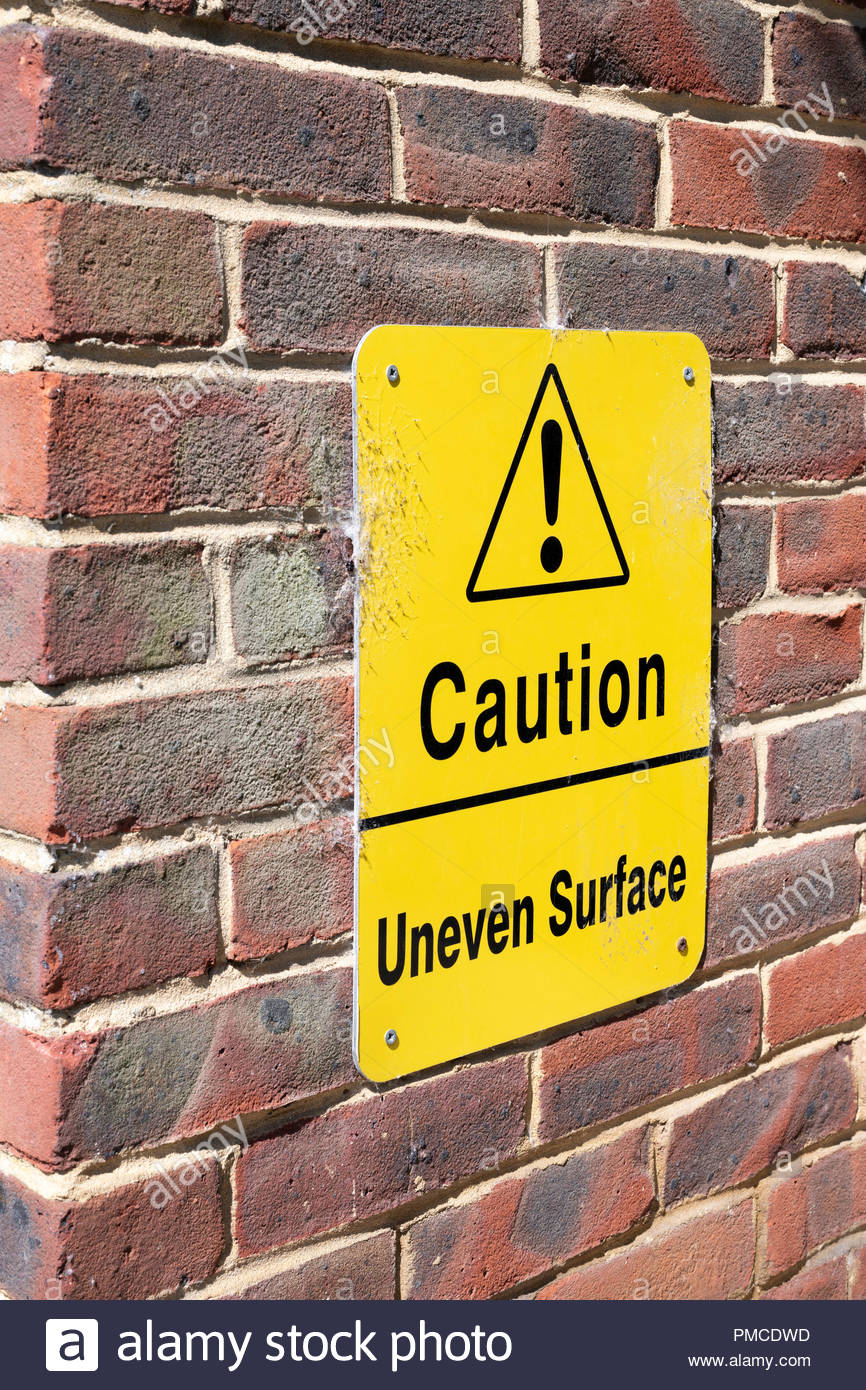 Caution uneven surface sign, Blandford, Dorset, England, UK - Stock Image