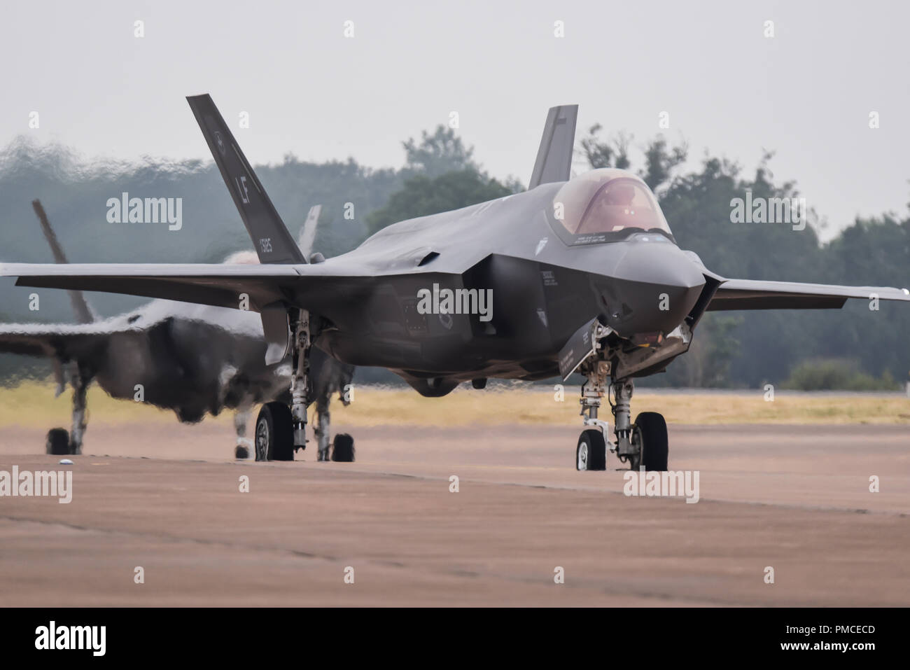US Air Force Lockheed Martin F-35A Lightning II at the Royal International Air Tattoo, RIAT, RAF Fairford. Taxiing in pair Stock Photo