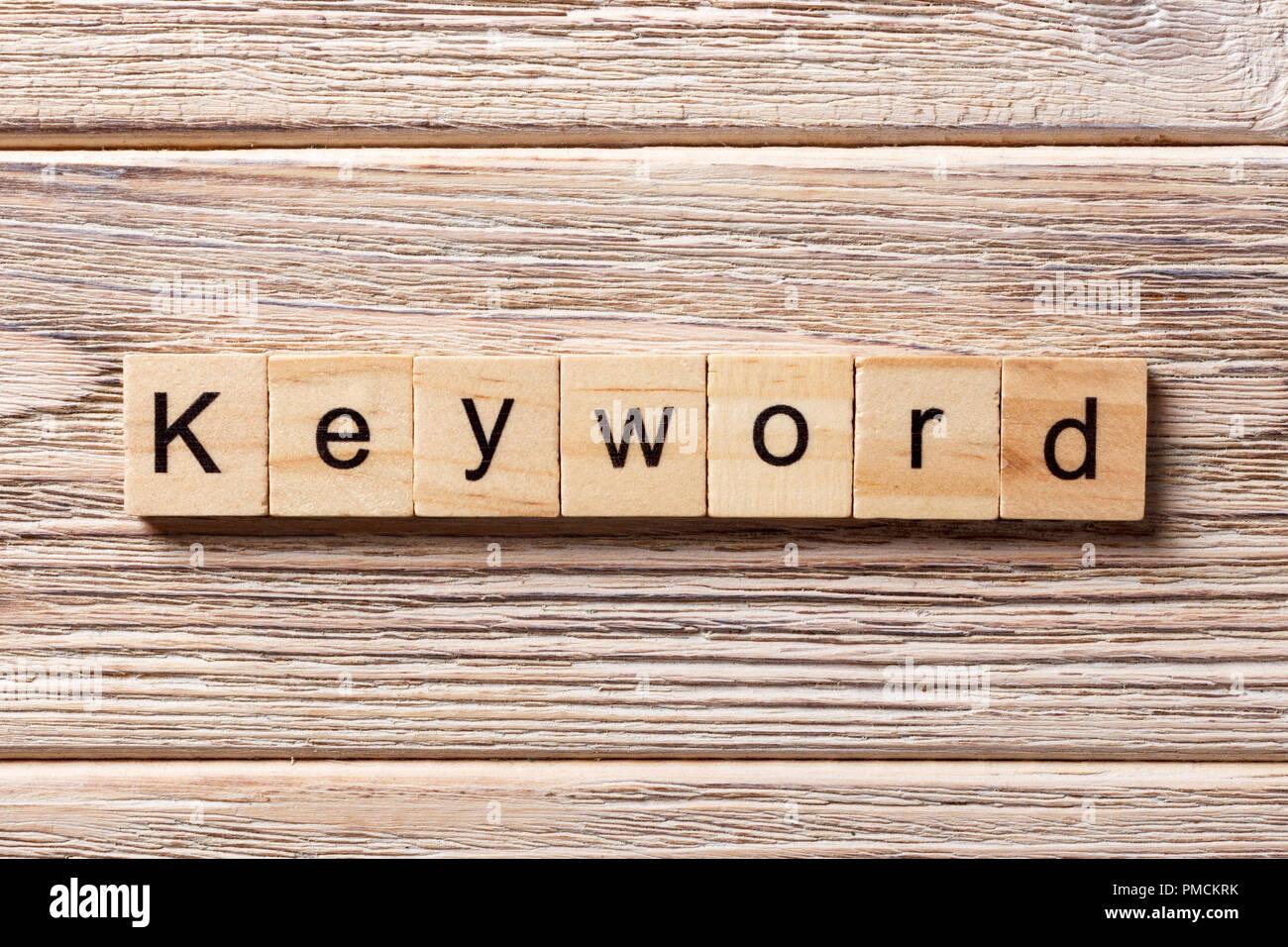 KEYWORD word written on wood block. KEYWORD text on table, concept. - Stock Image