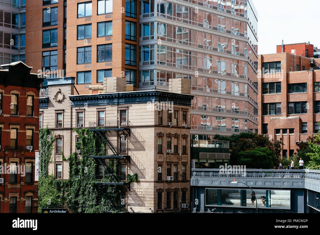New York City, USA - June 22, 2018: View of Chelsea from High Line. The High Line is an elevated linear park, greenway and rail trail. It was created  - Stock Image