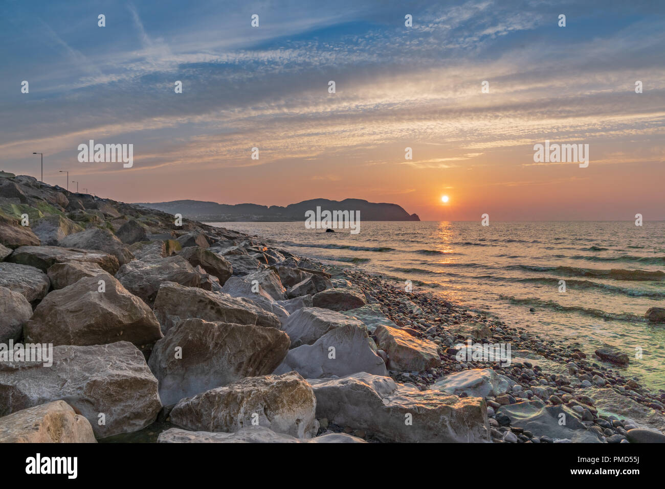 Sunset over the Welsh coast in Rhos-on-Sea, Conwy, Wales, UK - Stock Image