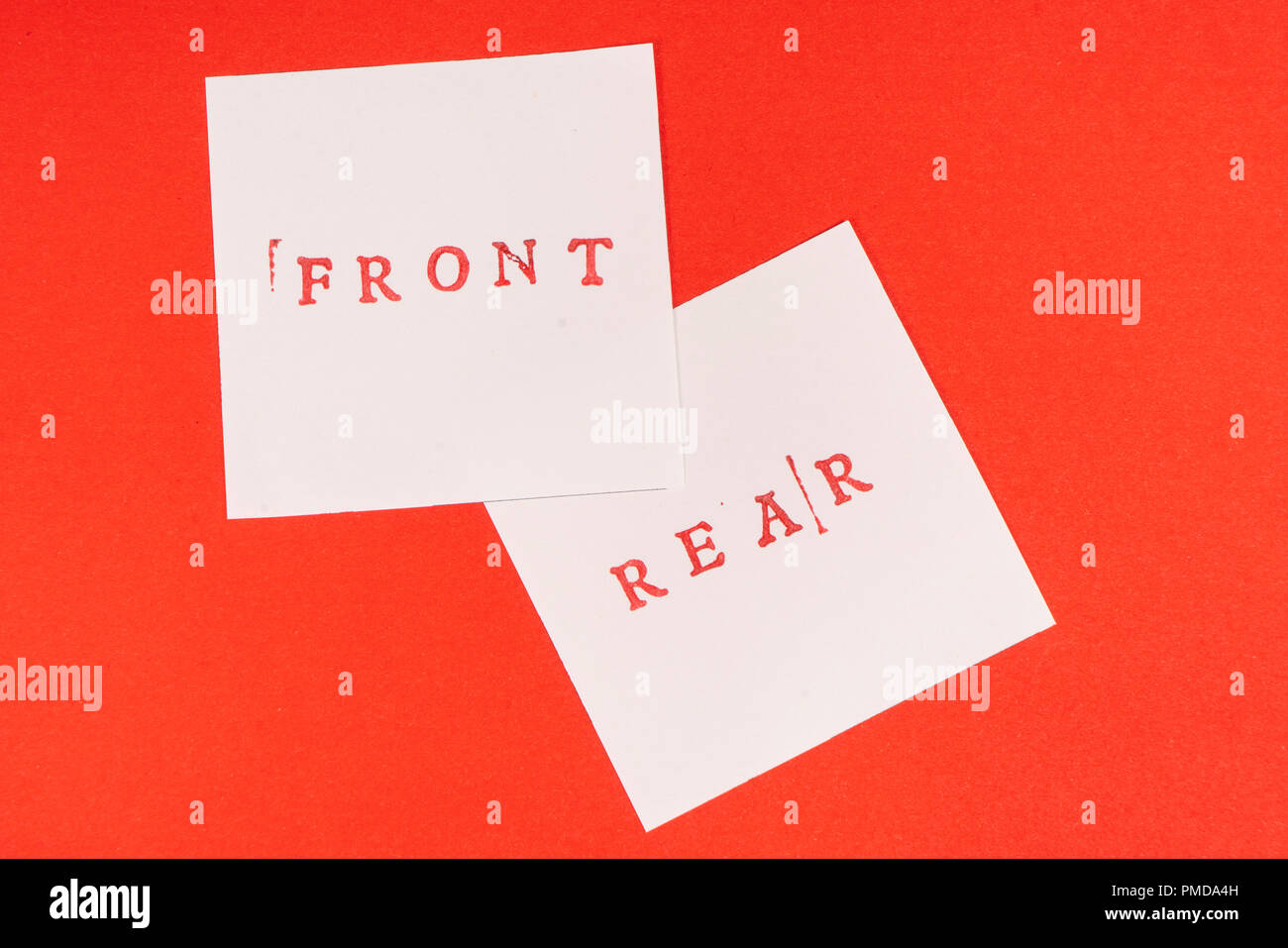 the contrast between the front and rear words printed on two sheets of paper - Stock Image