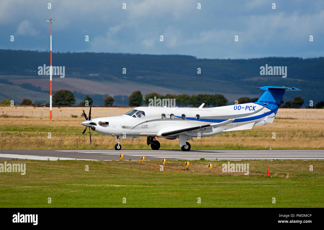 A Pilatus pc12/47e turbo prop arriving at Inverness Dalcross airport on a short stay before flying on to Brussels. - Stock Image