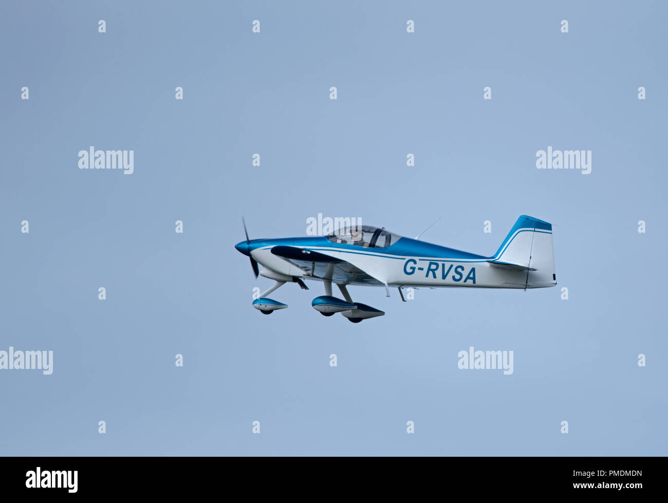 A two seat Van's RV-6A private aircraft leaving Inverness Dalcross airport on its flight south to North Weald Essex. Stock Photo