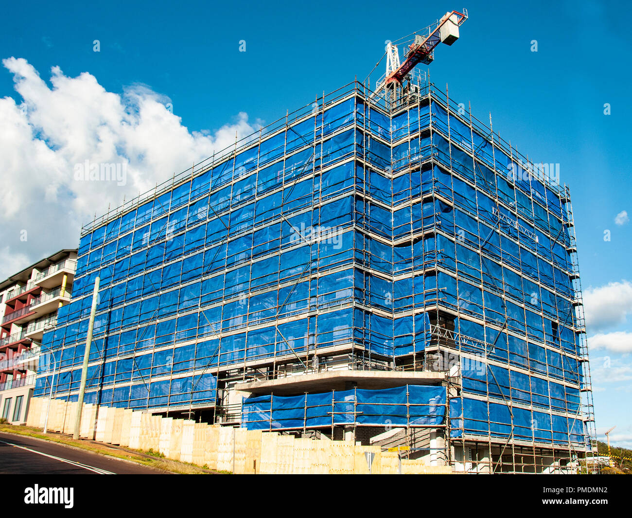 Gosford, New South Wales, Australia - September 7. 2018: Construction and building progress update 135.  A working tower crane on new home units build - Stock Image