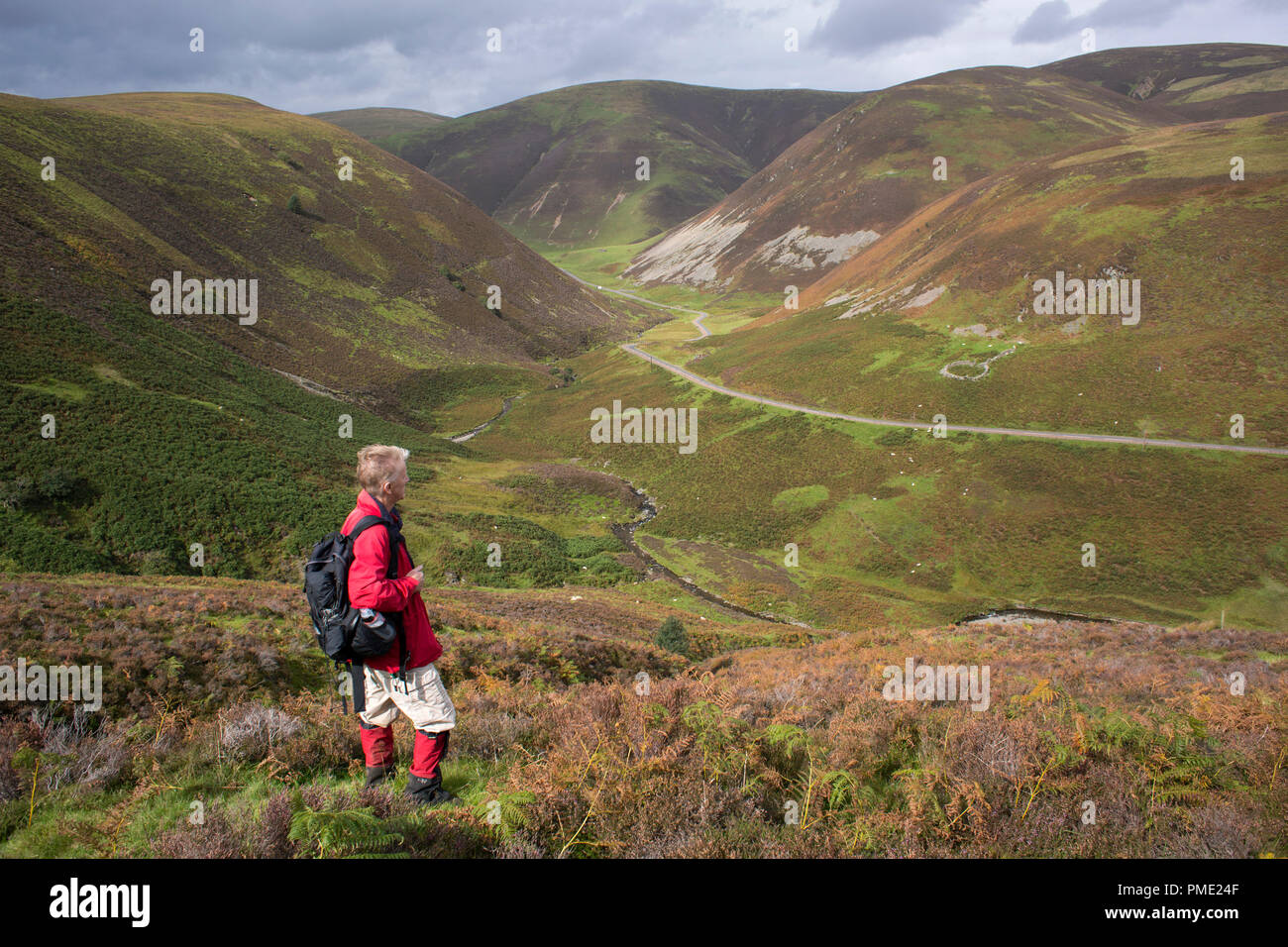 On the ancient path Dempster Road looking down and across the Mennock Pass tp Auchengruith Craig with Brown Hill, Wether Hill and White Dod behind - Stock Image