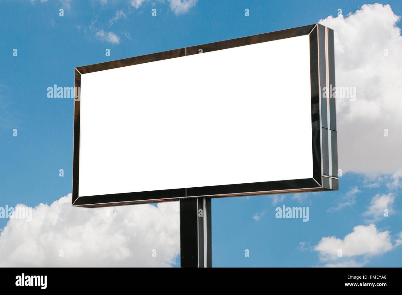 An empty billboard for advertising against the blue sky. - Stock Image