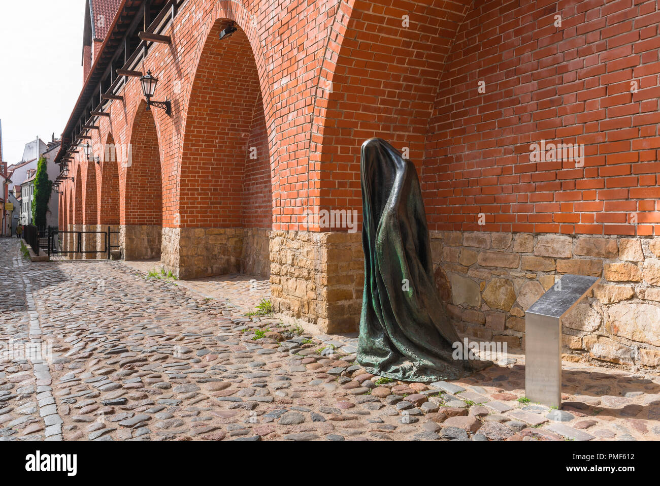 Old Riga city wall, view of the medieval city wall in Troksnu Iela including a modern sculpture titled The Ghost, Riga, Latvia. - Stock Image