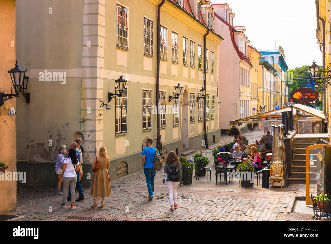 View of tourists sightseeing in Tornu Iela, a popular and historic street in the medieval center of Old Riga, Latvia. - Stock Image