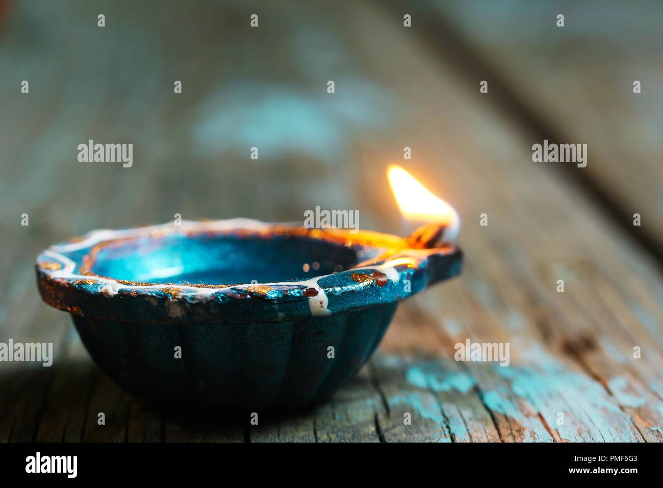 Happy Diwali - Colorful Clay Diya lit during Deepavali festival of lights, selective focus Stock Photo