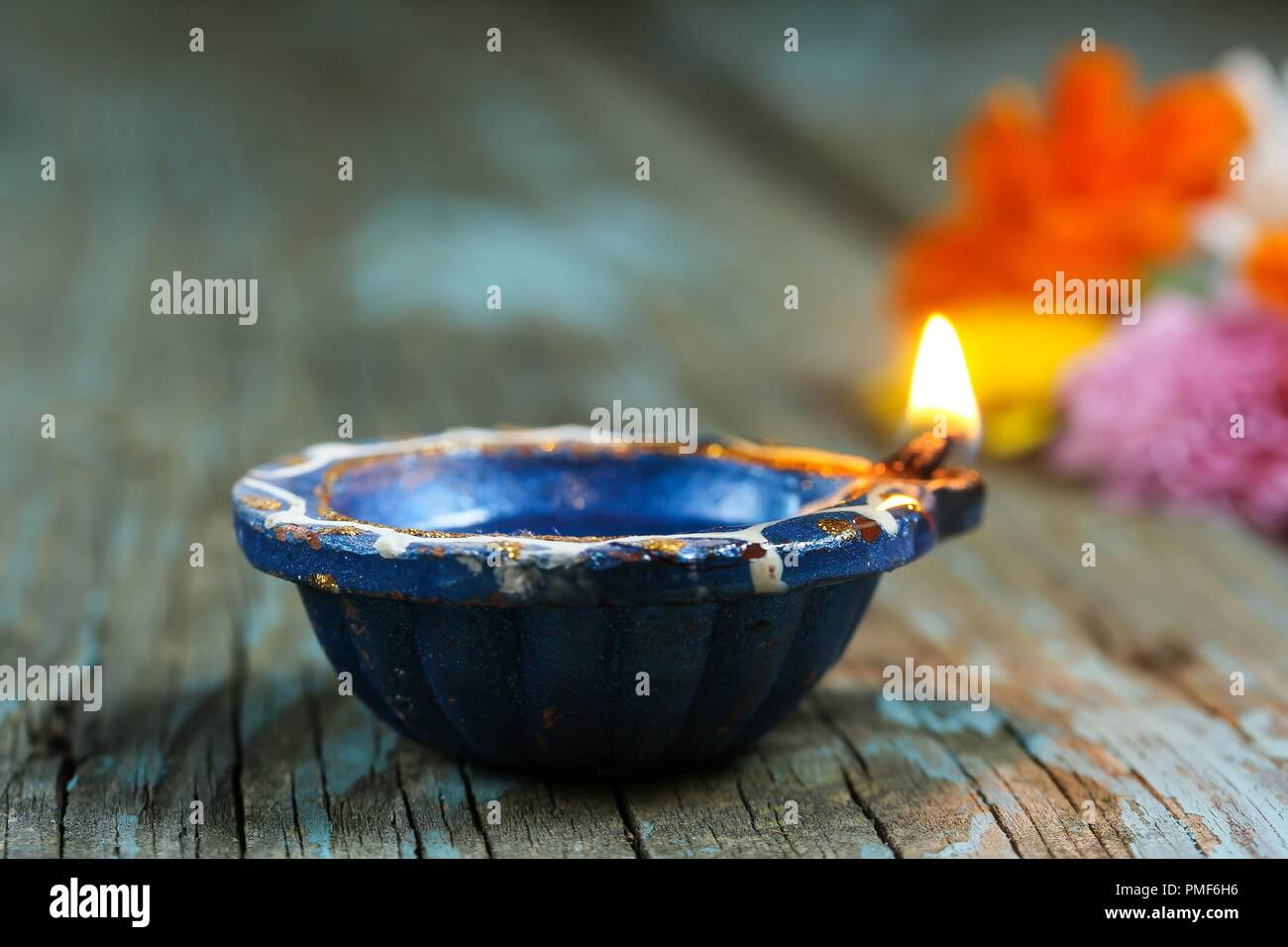 Happy Diwali - Colorful Clay Diya lit during Deepavali festival of lights, selective focus Stock Photo
