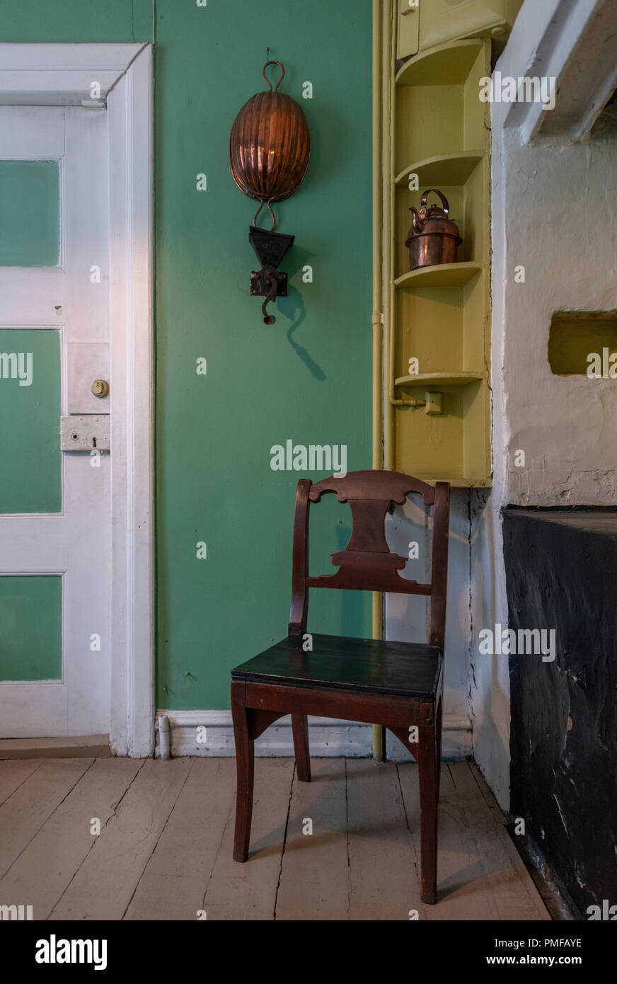 Merchant's apartment at the Stavanger Maritime Museum. The rooms are from around 1910. The kitchen has a particularly unusual colour scheme! - Stock Image