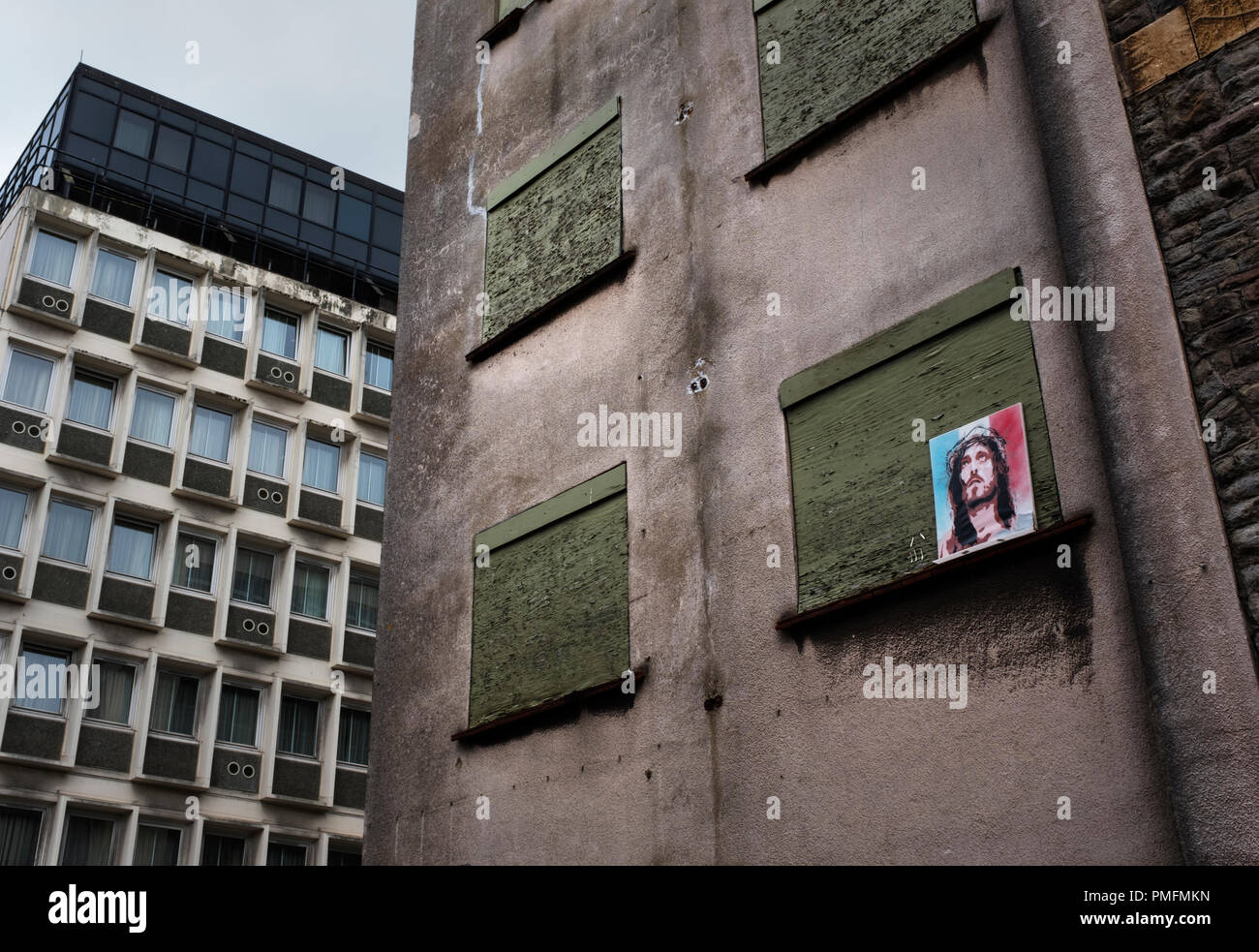 Picture of Robert Powell as Jesus on the side of a boarded up building in the centre of Bristol, U.K. - Stock Image