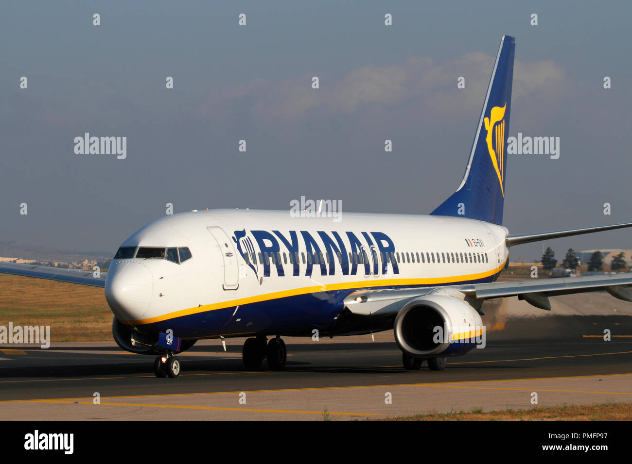 Boeing 737-800 belonging to budget airline Ryanair taxiing for departure from Malta. Low cost flights and mass tourism. - Stock Image