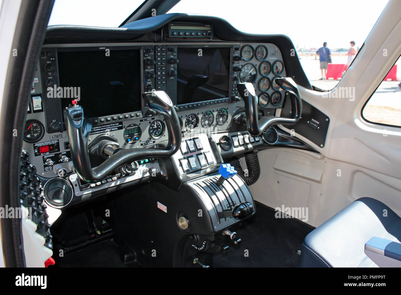 Tecnam P2006T light aircraft cockpit interior with modern display screens in the instrument panel - Stock Image