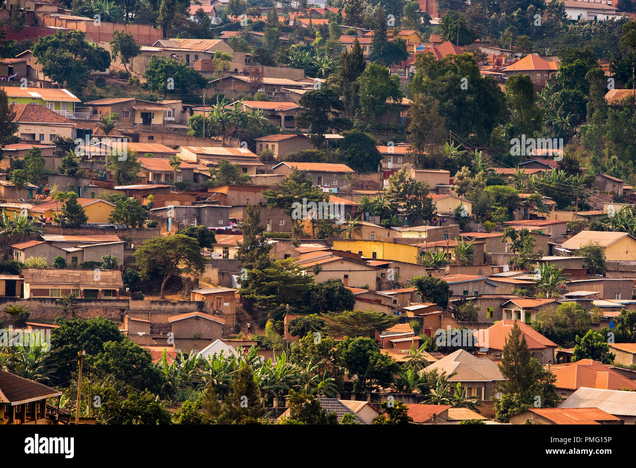 View of small, closely packed houses on a hillside in Nyamirambo, a semi-rural suburb of Kigali, Rwanda - Stock Image