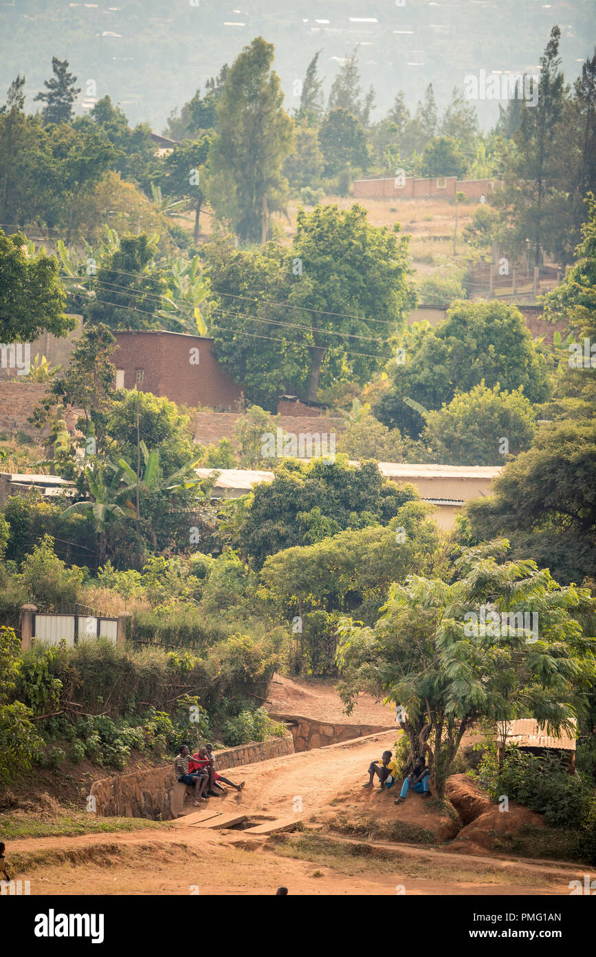 View of bakclit trees and dirt paths on a hillside in Nyamirambo, an outlying, semi-rural suburb of Kigali, Rwanda - Stock Image