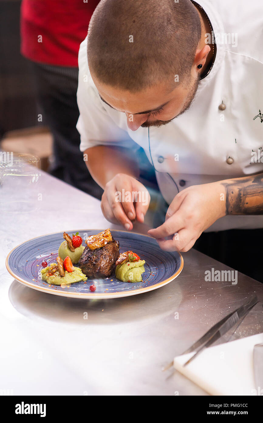 Professional Food Decoration In Restaurant Kitchen Cook Doing A Great Job Stock Photo Alamy