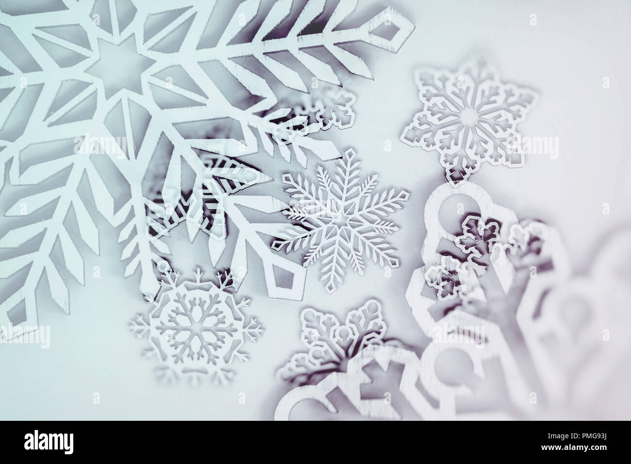 Abstract christmas background, snowflakes of different shapes and colors, blurred selective focus - Stock Image