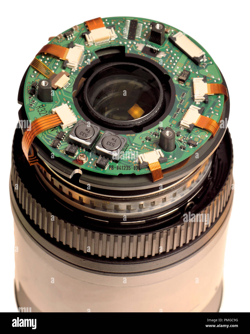 Inside a photographic lens - part of the electronics and rear element of a Nikon 70-300 lens - Stock Image