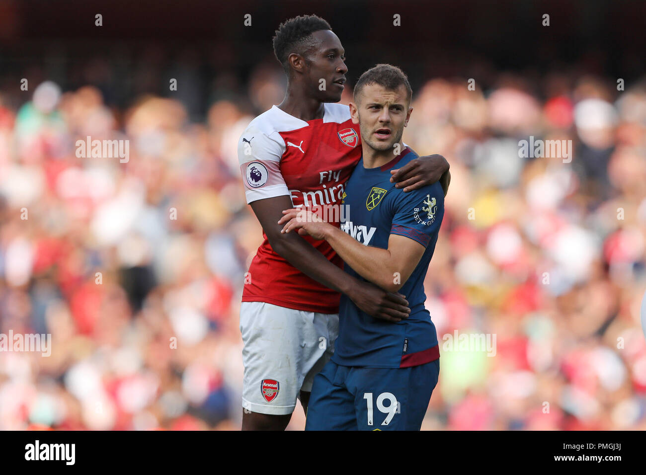 Jack Wilshere of West Ham United is consoled by Danny Welbeck of Arsenal after the match - Arsenal v West Ham United, Premier League, Emirates Stadium - Stock Image