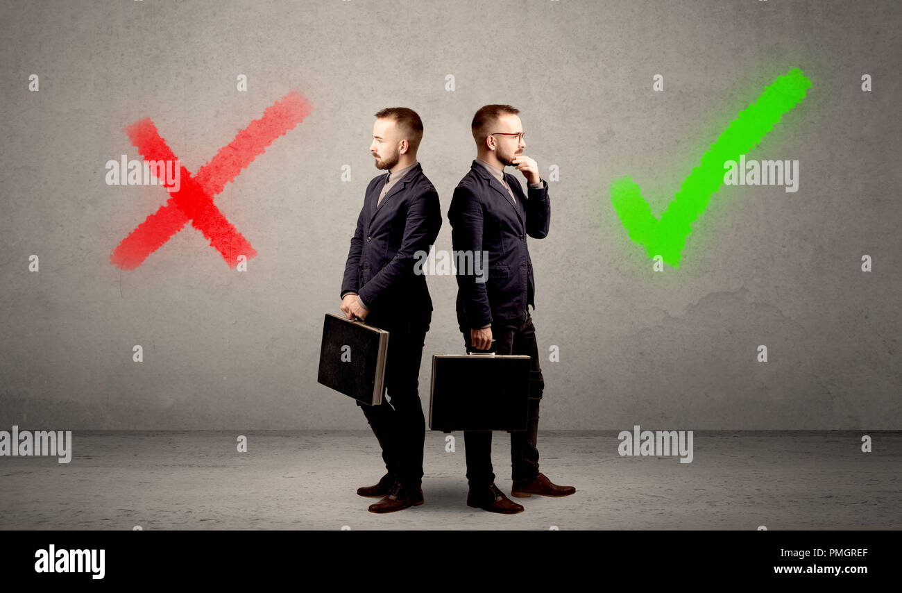 Young conflicted businessman choosing between a right and a wrong direction - Stock Image