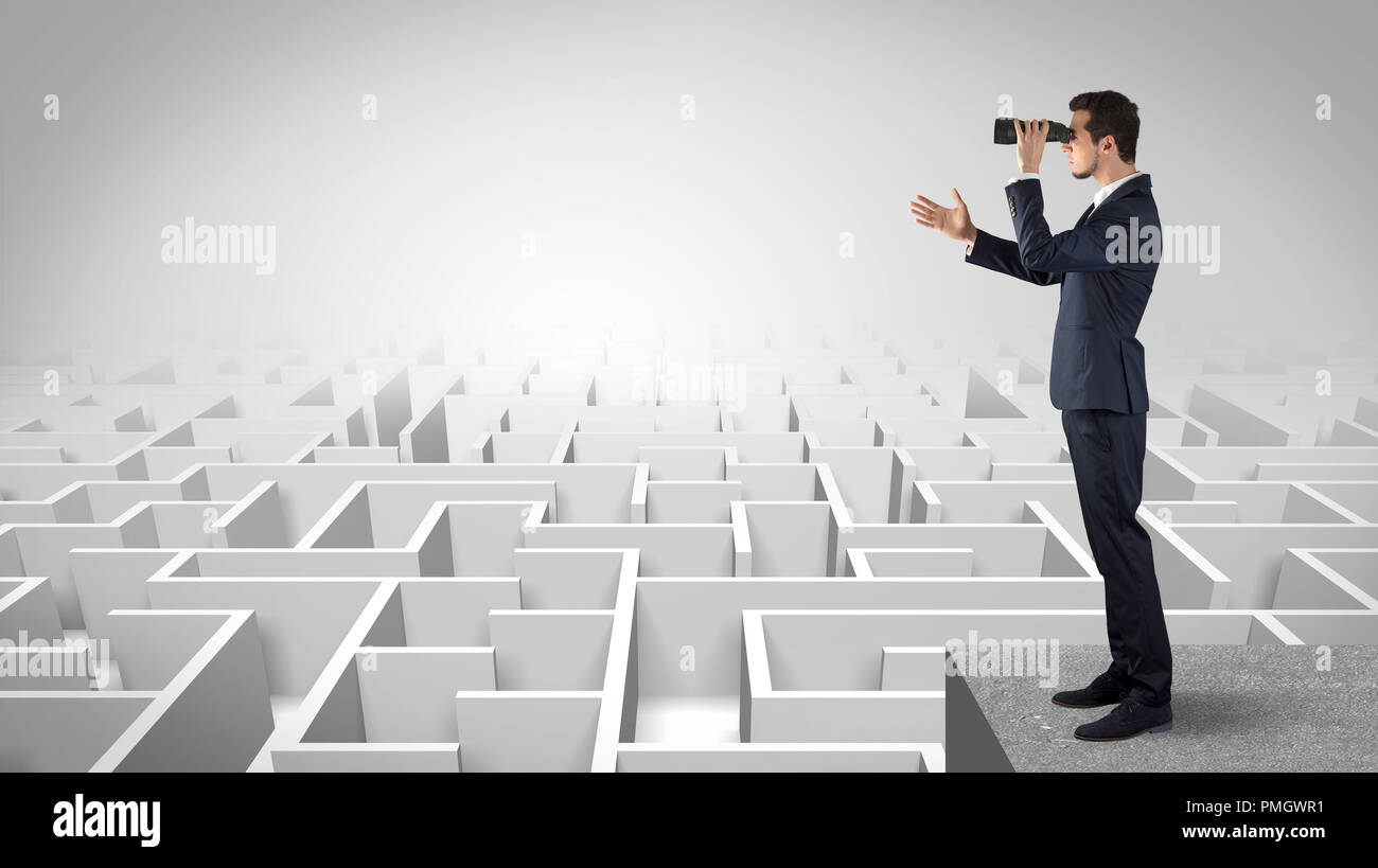 Businessman standing on maze and looking forward to the future concept  - Stock Image