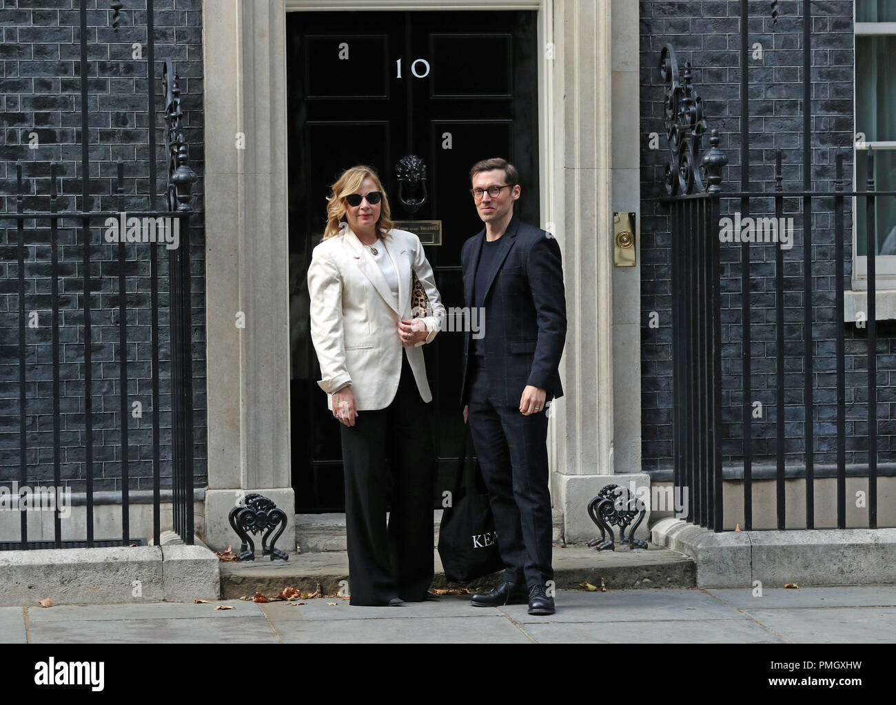 Erdem Moralioglu (right), arriving at Downing Street, central London to attend a reception hosted by Prime Minister Theresa May to mark the end of London Fashion Week. - Stock Image