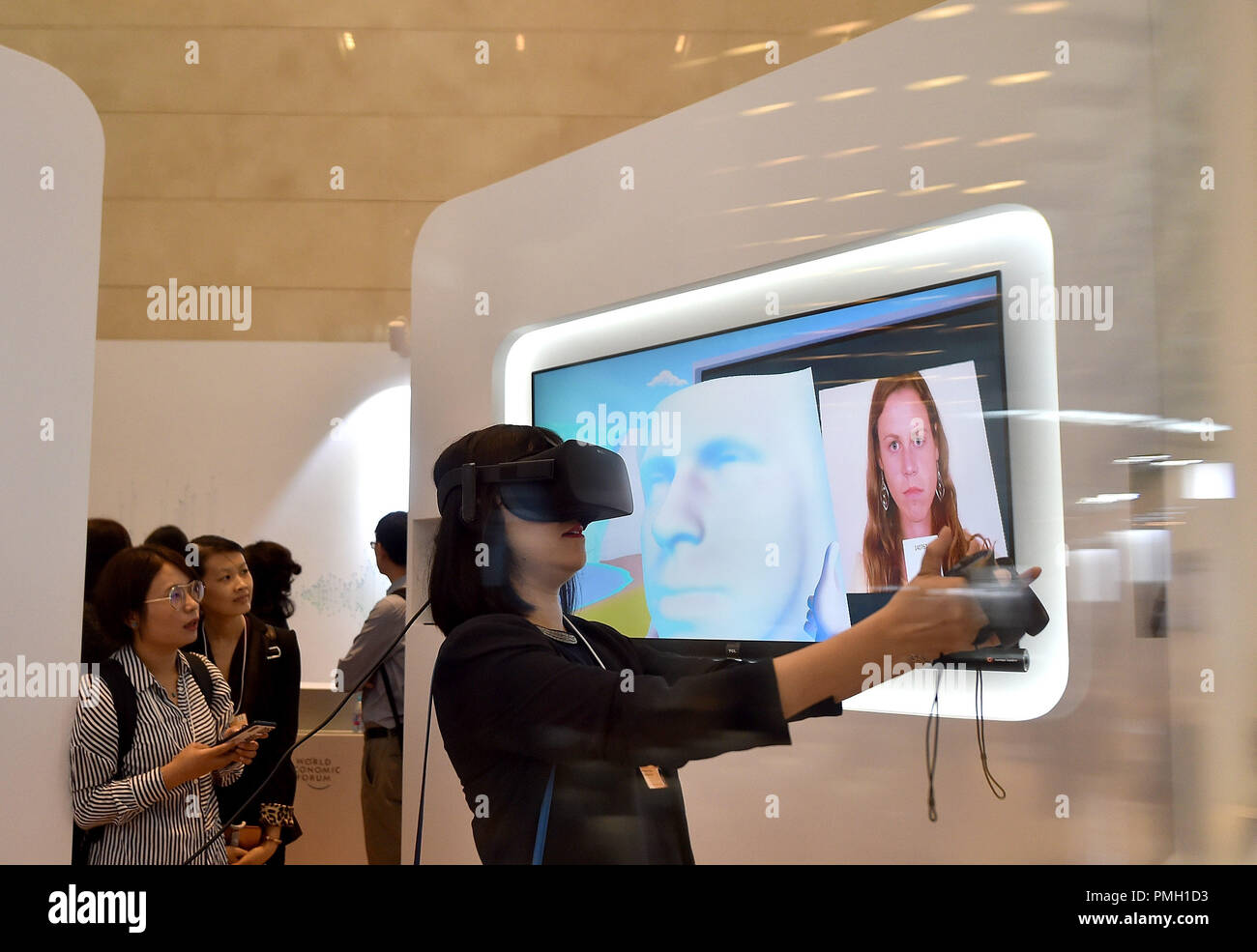 Tianjin, China  18th Sep, 2018  A participant experiences VR
