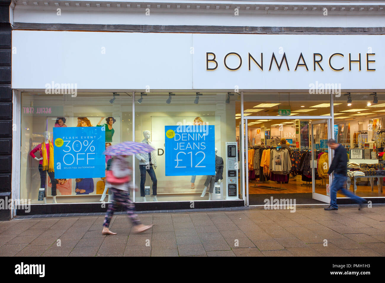 BonMarche fashion store Dundee, Scotland. UK Weather 18/09/2018.  Rainy start to the day in the city centre with heavy rain forecast for later in the day including unposed shots of people  Credit; MediaWorldImages/AlamyLiveNews - Stock Image