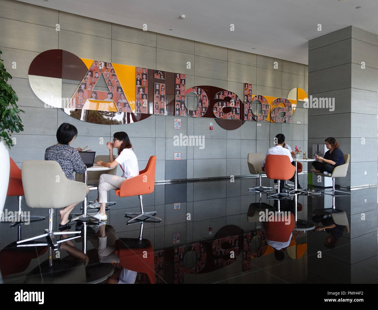 c96665693f74b9 Employees sit in a foyer of the company headquarters of the Chinese online group  Alibaba on chairs in front of a company logo. Credit  Andre Klohn dpa Alamy  ...