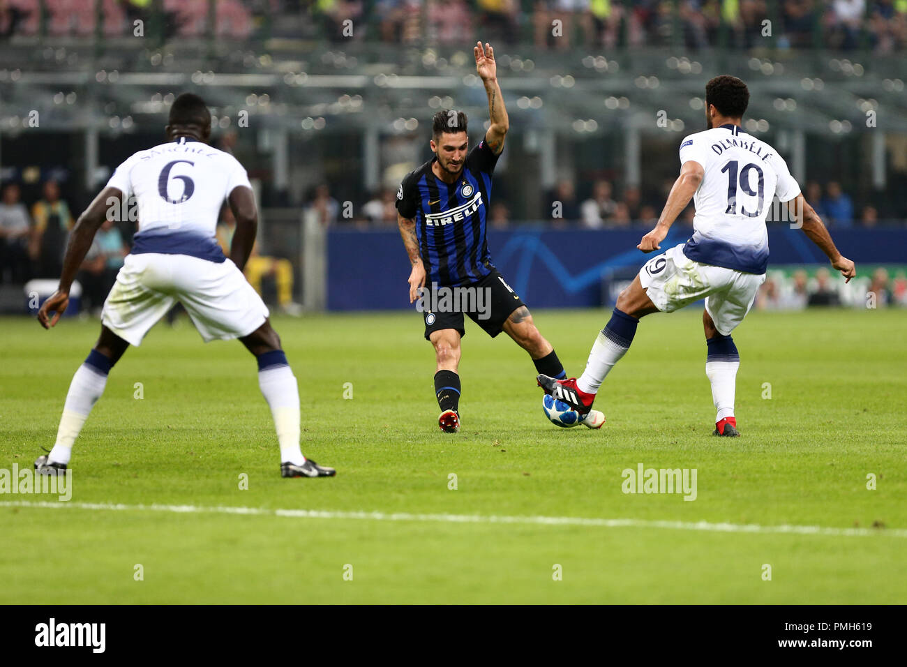 Milano, Italy. 18th September, 2018.  Moussa Dembele' of Tottenham Hotspur Fc and   Matteo Politano of FC Internazionale in action during Uefa Champions League  Group B match  between FC Internazionale and Tottenham Hotspur Fc. Credit: Marco Canoniero/Alamy Live News - Stock Image