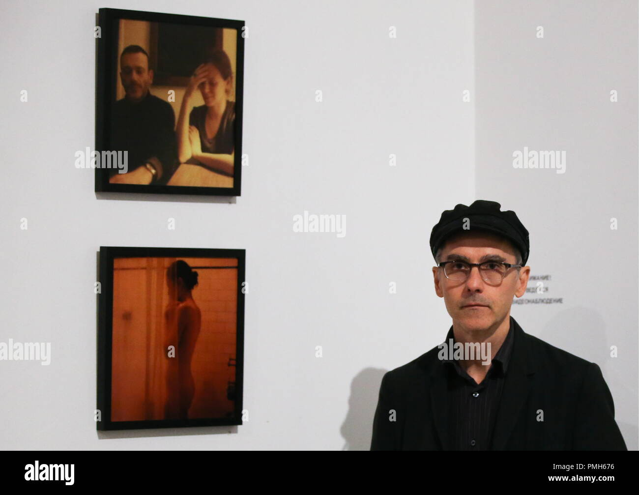 """ST PETERSBURG, RUSSIA - SEPTEMBER 18, 2018: American filmmaker Jem Cohen at an exhibition of his photos titled """"Jem Cohen. Looking for the Permanent Ghost"""" opened at St Petersburg's KGallery as part of the 28th Message to Man International Film Festival. Peter Kovalev/TASS Stock Photo"""
