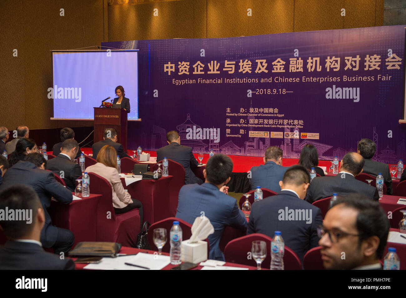 (180918) -- CAIRO, Sept. 18, 2018 (Xinhua) -- Representatives of Egyptian and foreign banks and Chinese companies attend the seminar 'Egyptian Financial Institutions and Chinese Enterprises Business Fair' in Cairo, Egypt, Sept. 18, 2018. China Development Bank (CDB), the largest Chinese bank for foreign investment and financing cooperation, expressed Tuesday its confidence in the Egyptian economy and the economic reform program the Egyptian government launched. (Xinhua/Meng Tao) - Stock Image