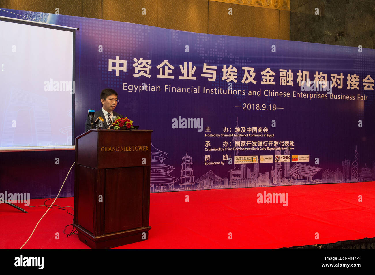 (180918) -- CAIRO, Sept. 18, 2018 (Xinhua) -- Xu Yuankun, representative of China Development Bank Cairo Office, speaks during the seminar 'Egyptian Financial Institutions and Chinese Enterprises Business Fair' in Cairo, Egypt, Sept. 18, 2018.  China Development Bank (CDB), the largest Chinese bank for foreign investment and financing cooperation, expressed Tuesday its confidence in the Egyptian economy and the economic reform program the Egyptian government launched. (Xinhua/Meng Tao) - Stock Image