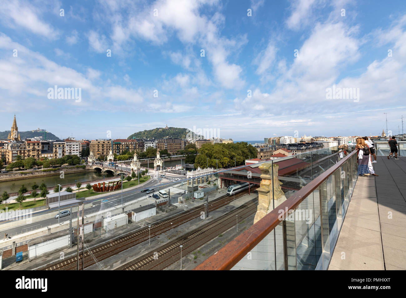 People viewing San Sebastián, with the María Cristina Bridge,  from the Terrace of Tabakalera, San Sebastián, Basque Country, Spain - Stock Image