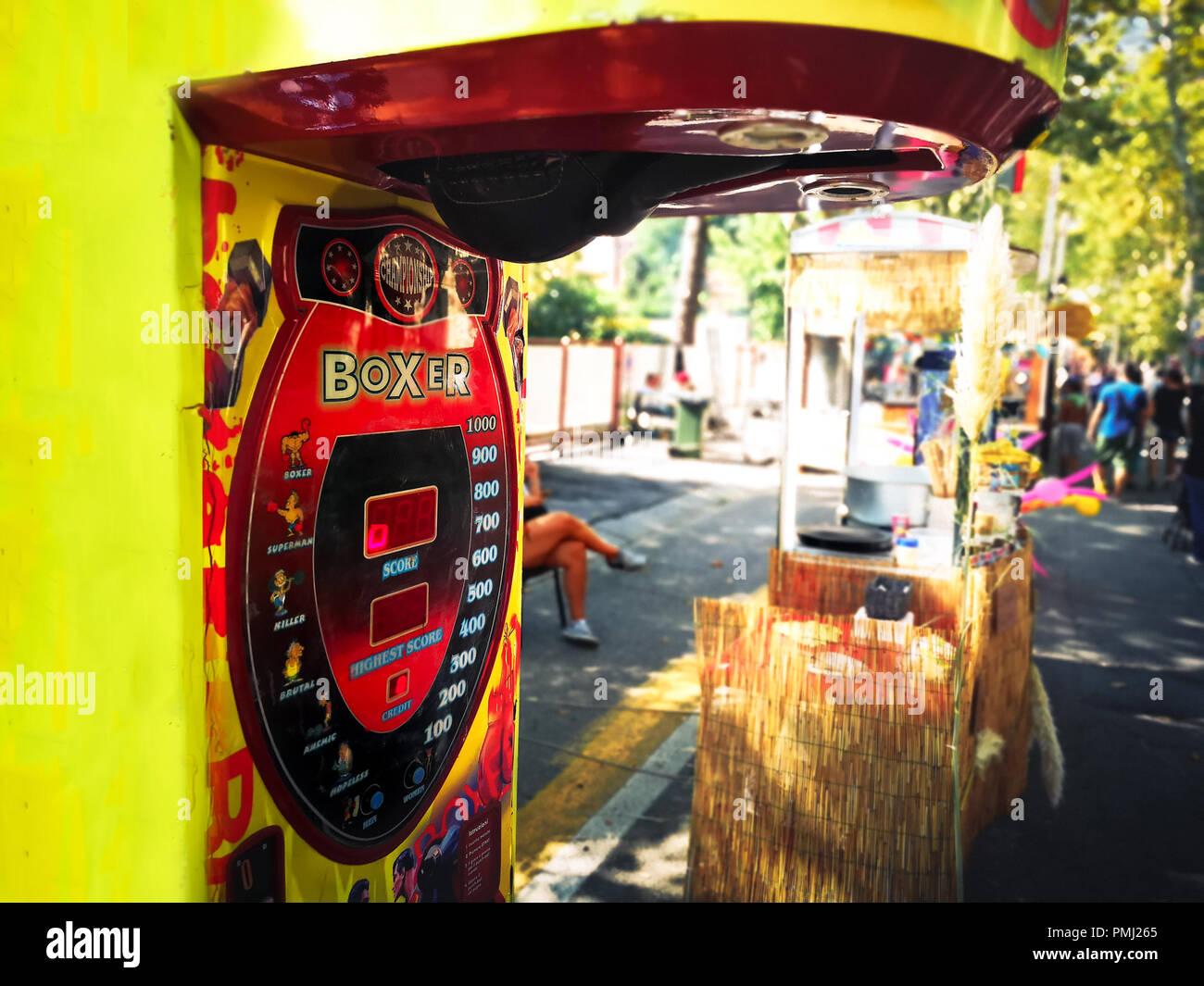 punch boxing speed bag arcade punch ball machine street fair luna park - Stock Image