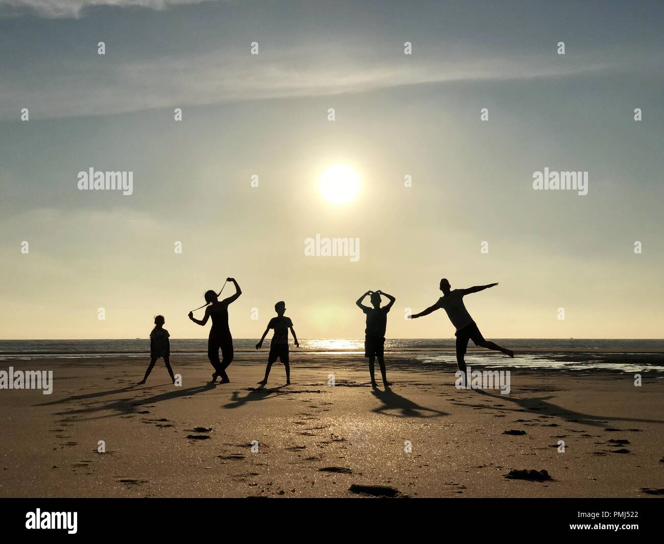 Silhouette of a family messing about on beach, Pointe Espagnole, La Tremblade, Charente-Maritime, France - Stock Image