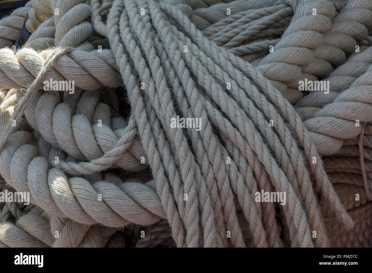 natural fibre cordage ropes in hemp, manila and sisal fibres knotted. - Stock Image