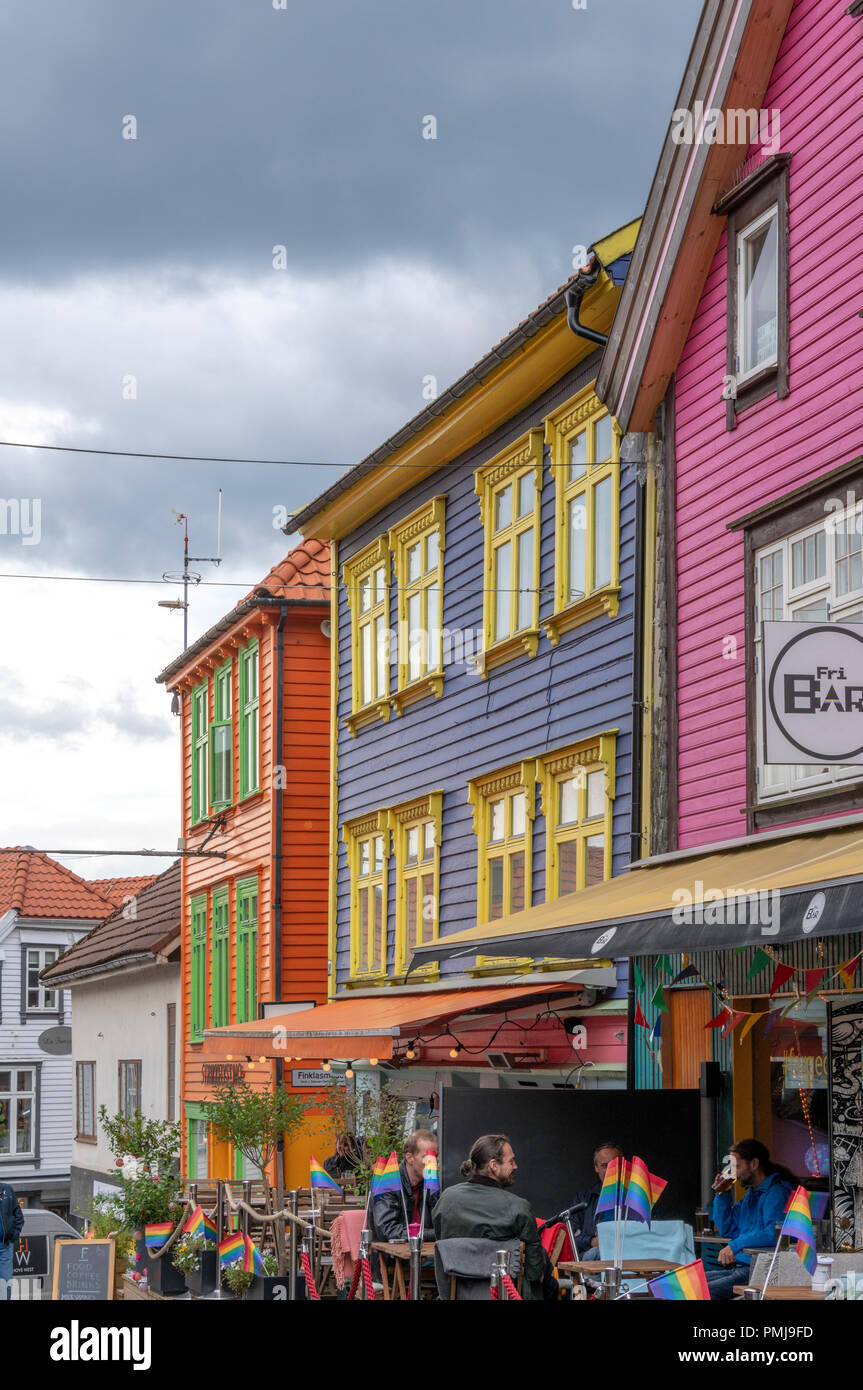 Colourful shops, bars, cafes and restaurants in this popular busy street close to where the huge cruise ships land. So often visited by tourists Stock Photo