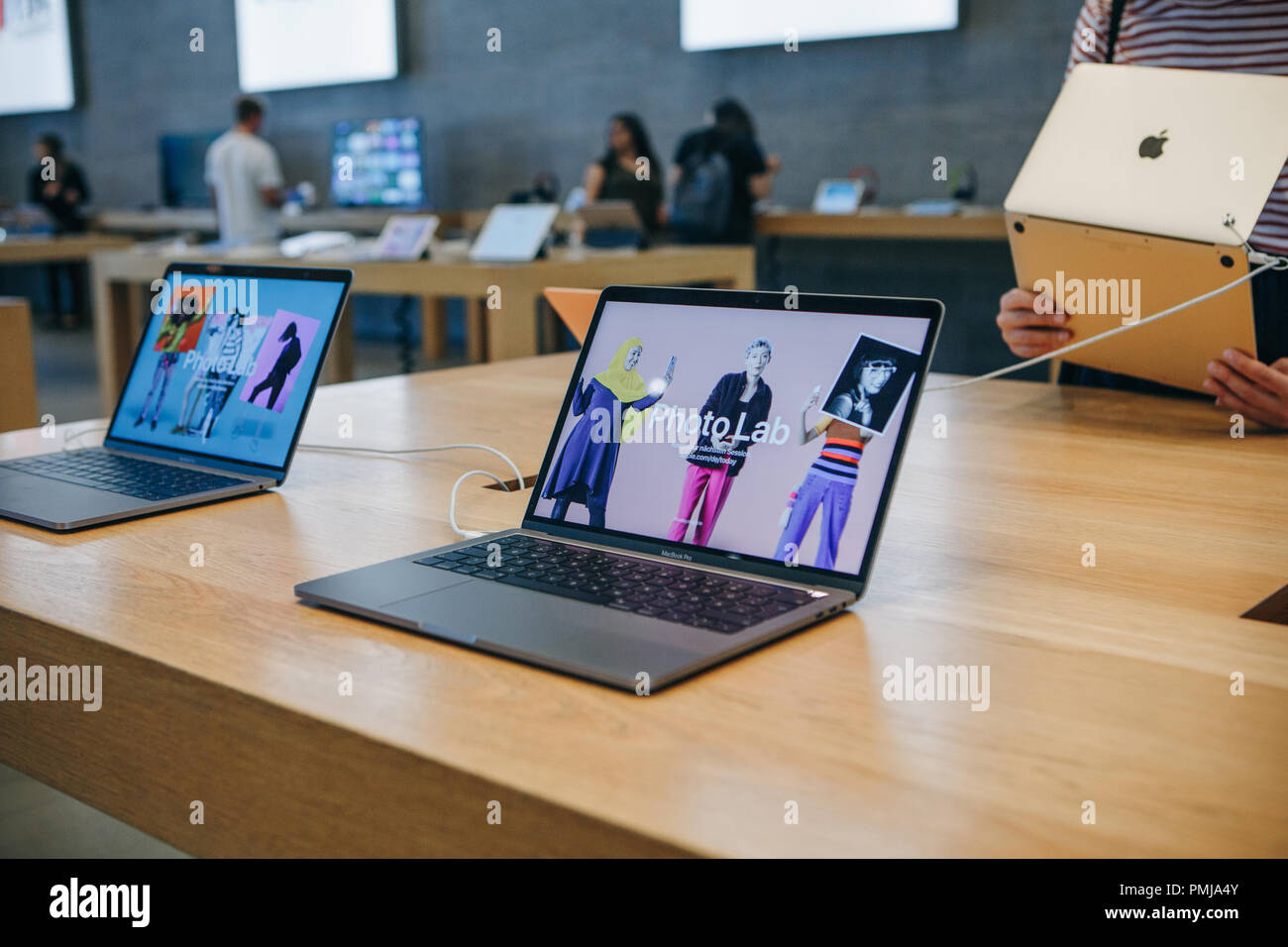 Berlin, August 29, 2018: Retail sale of new MacBooks in the official store of Apple in Berlin. Modern and stylish laptops. - Stock Image
