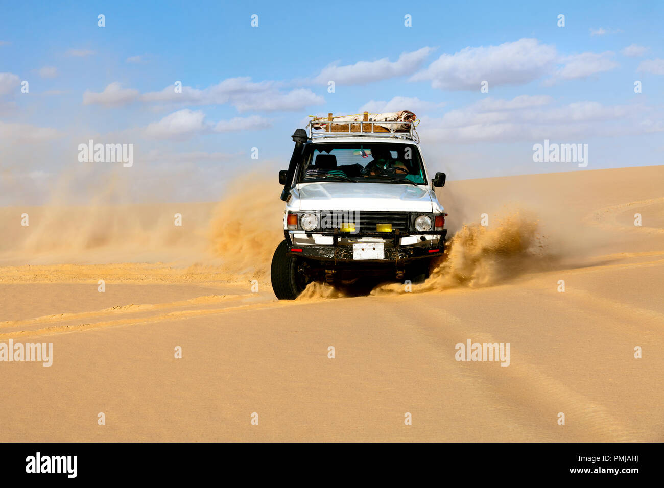 Off-road vehicles driving in Sahara sand desert - Stock Image