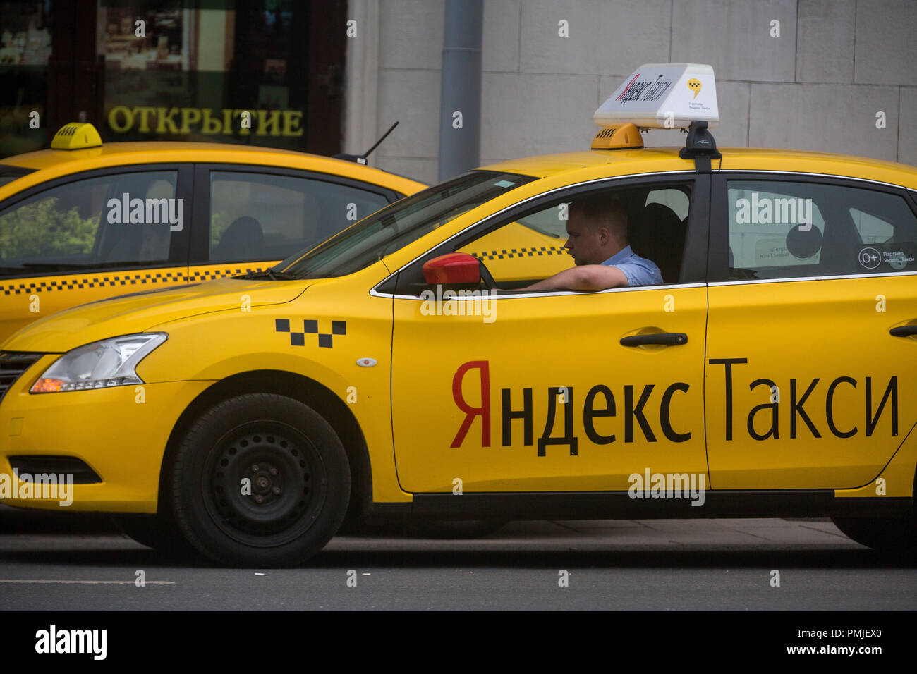 Yellow taxi with banner
