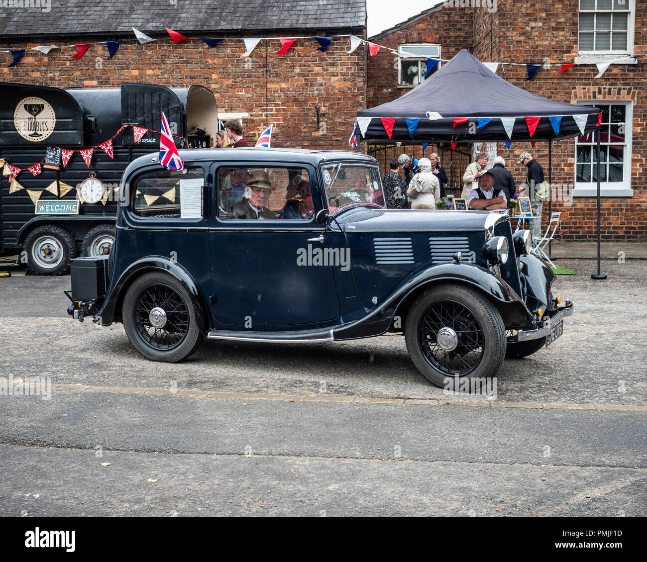 Two Senior Citizens Sit In A Classic Car At North Thoresby 1940 S