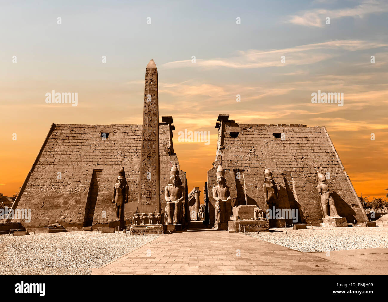 Entrance to Luxor Temple at sunset, a large Ancient Egyptian temple complex located on the east bank of the Nile River in the city today known as Luxo - Stock Image