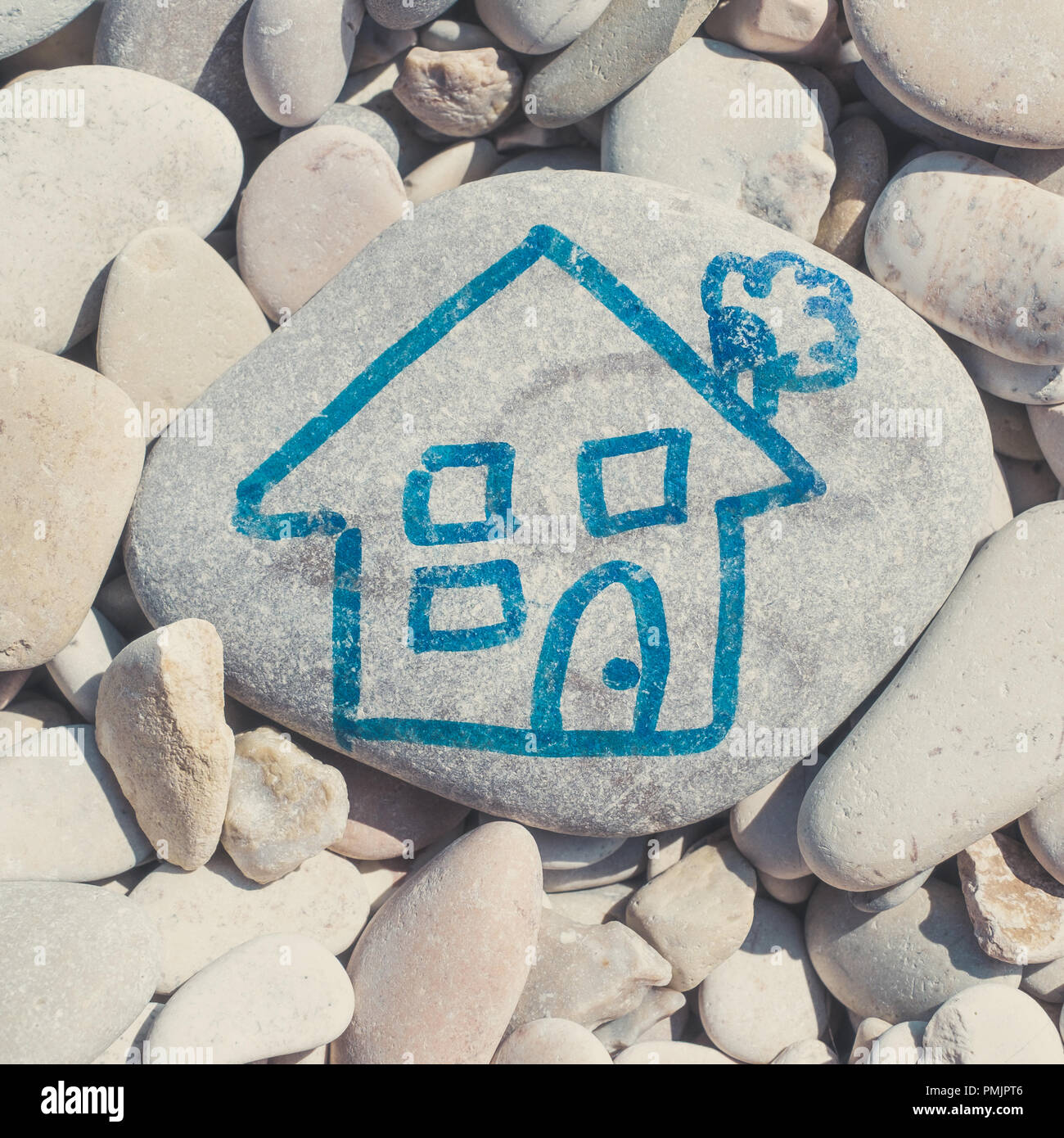 A house childlike drawn on a stone - Stock Image