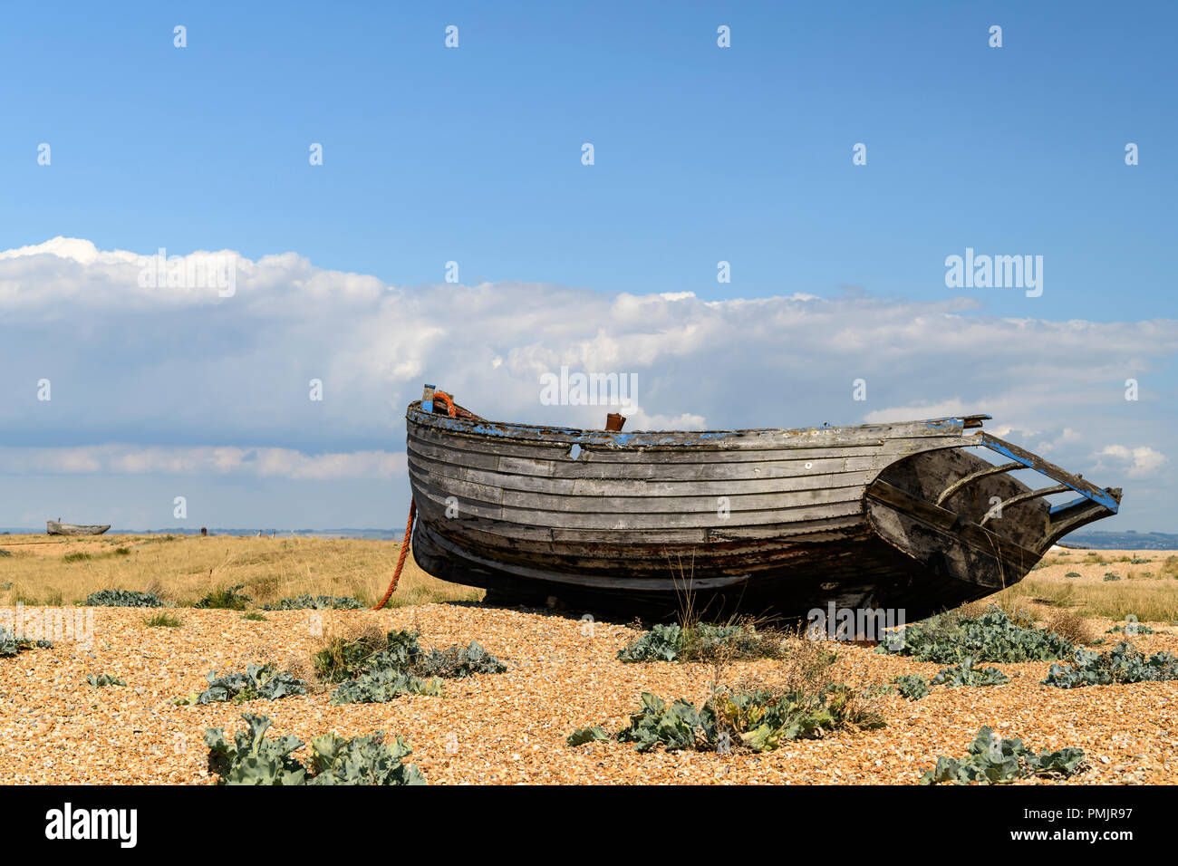 One boat beached on the Dungeness shingle in Kent, England. 31 August 2018 Stock Photo