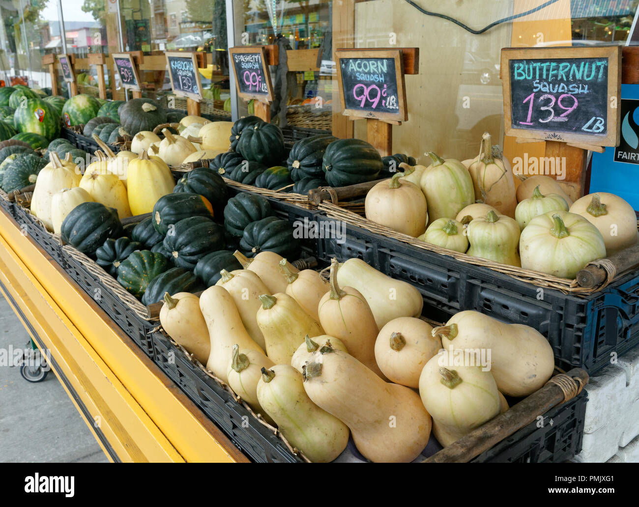 Varieties of squash for sale outside a grocery store on Main Street in Vancouver, BC, Canada Stock Photo